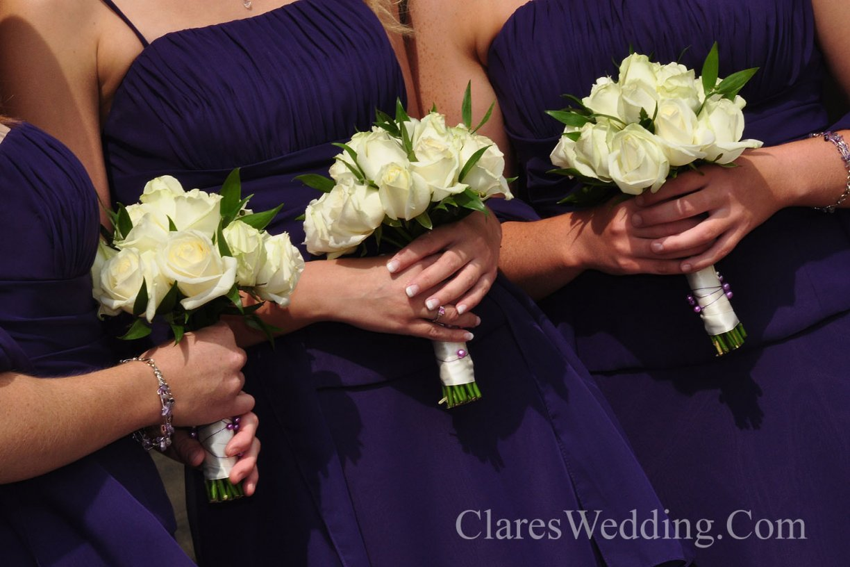 Usually a smaller but similar style to the Bride's handtie. Available is in different sizes depending on age of Bridesmaid