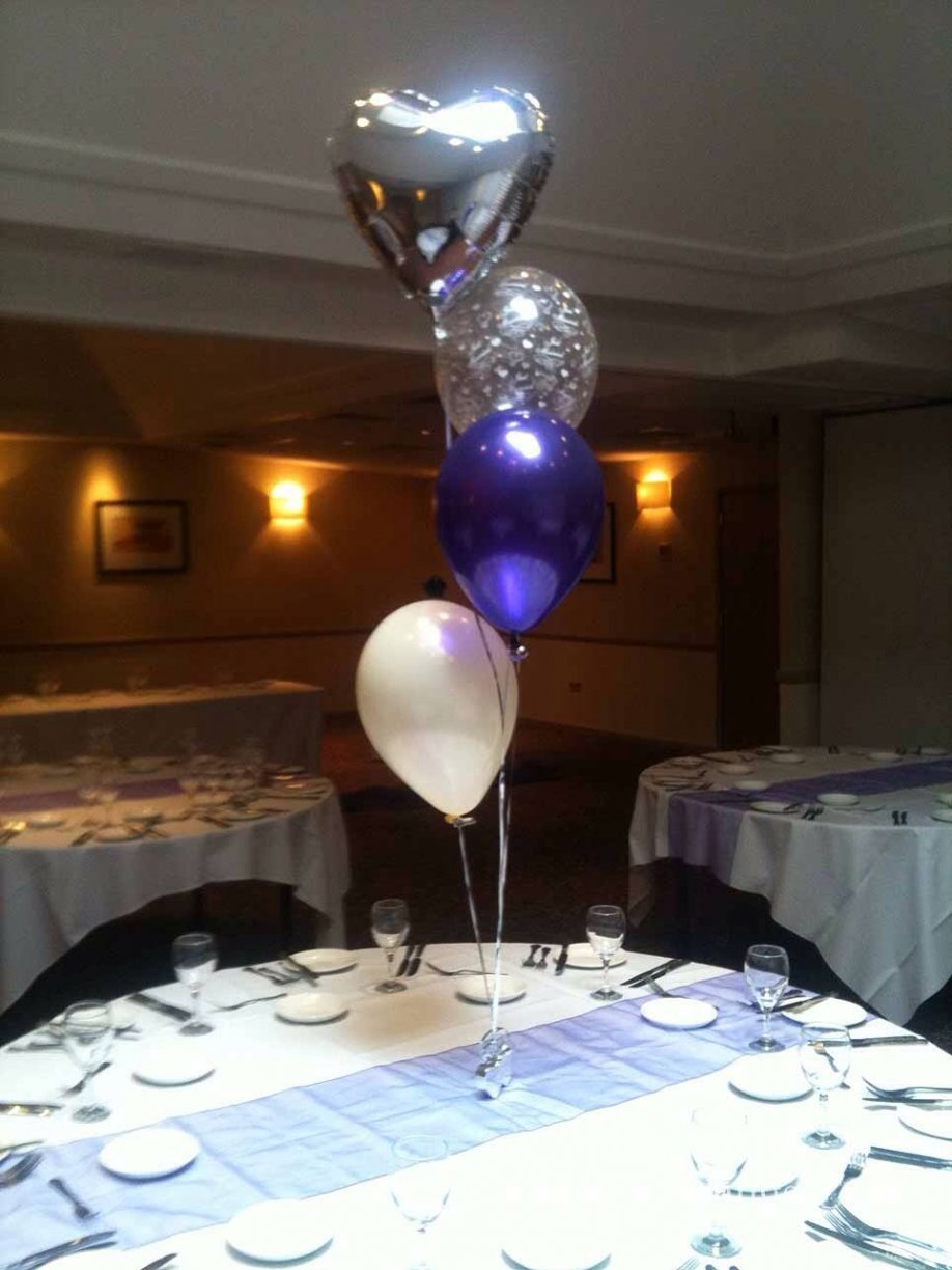 A Heart Foil, coloured latex, Ivory latex & Just Married see through balloon. A taller more elegant table arrangement adding atmosphere!