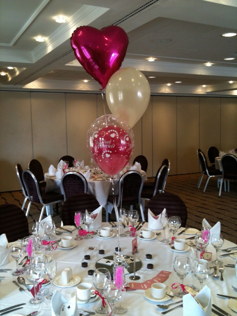 Beautiful combination of Heart Foil, Theme colour latex balloon inside a transparent Just Married Balloon & Ivory latex balloon.