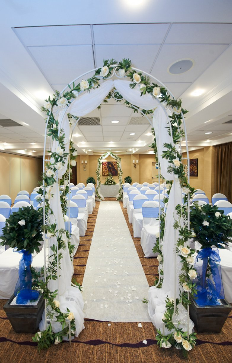 Beautifull Ceremony Arches dressed with Silk Ivory Roses, Variegated Ivy & Organza
