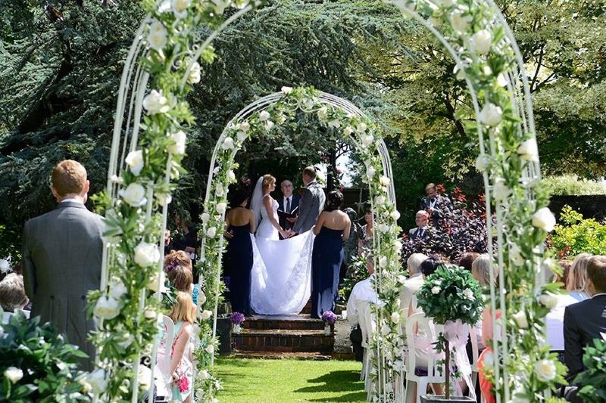 Dressed with Organza Sashes, Silk Roses & Variegated Ivy & Topiary Trees.More Arch Packages