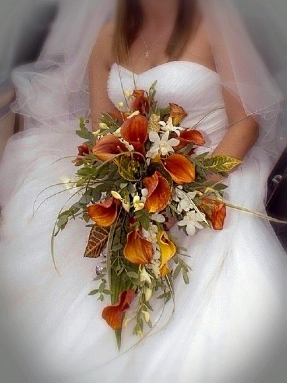A teardrop style bouquet usually fuller, longer!