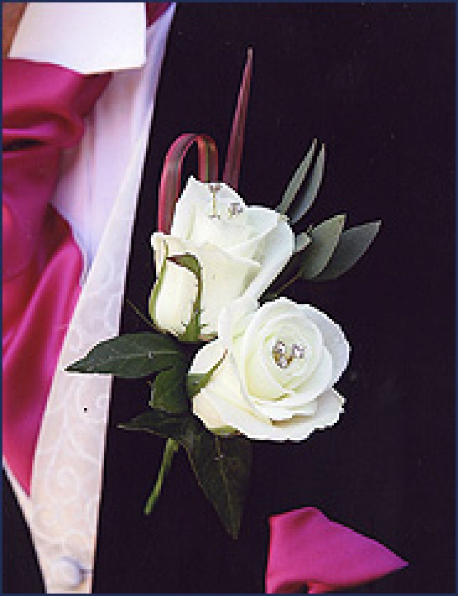Usually for the men with the Groom having a double flower with foliage & Single flowers for the Grooms men! Image shown is finished with Diamanté!